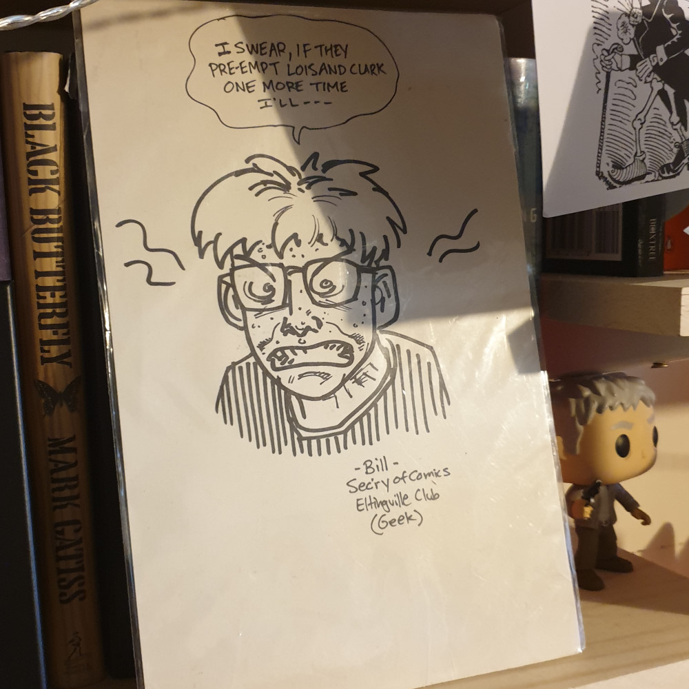 A comic board with a hand-drawn sketch by Evan Dorkin