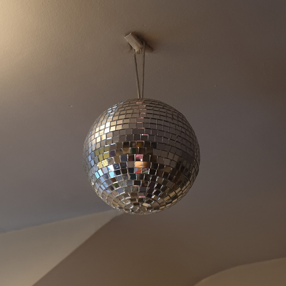A mirror ball hanging from the ceiling