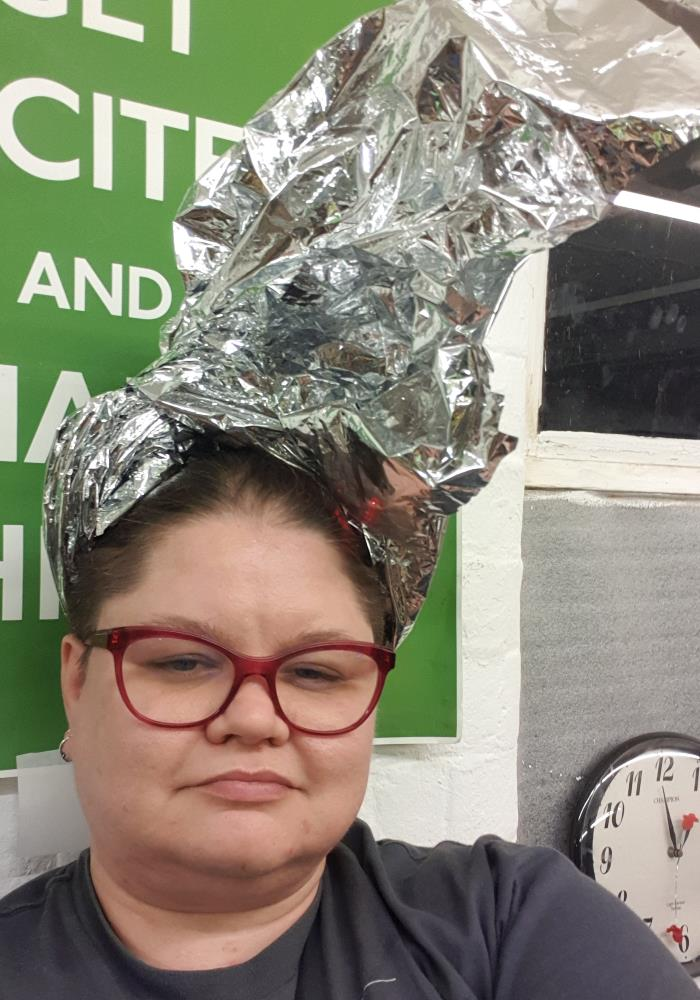 Me wearing the remnants of the Mylar blanket tied up as a very elaborate hat.