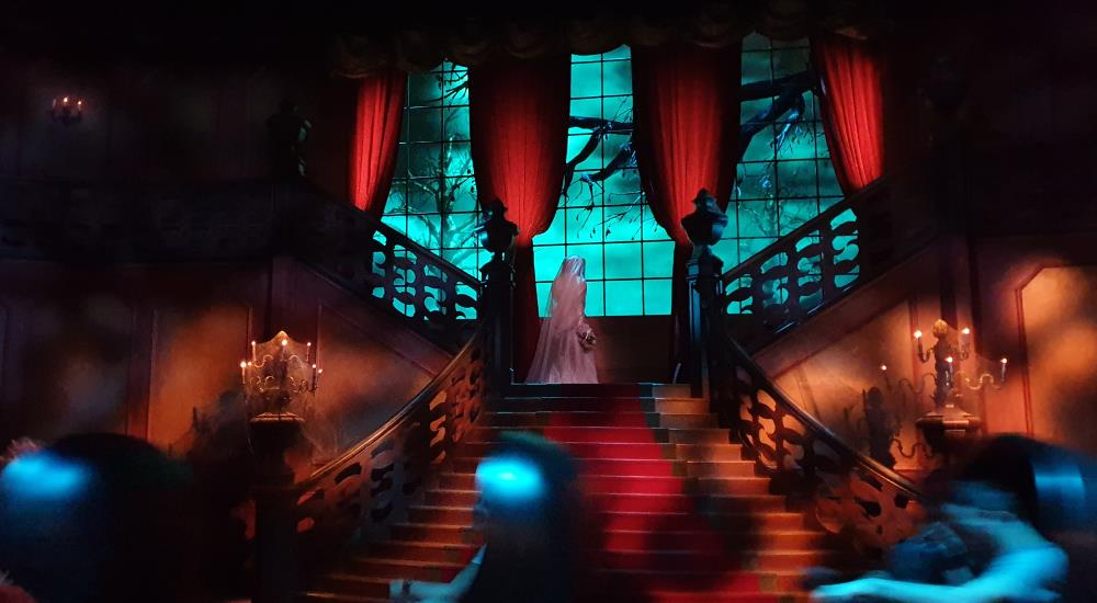 The bride at the omnimover boarding area in Phantom Manor