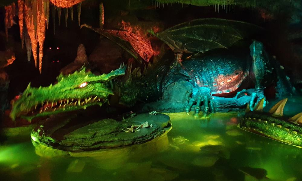 The animatronic dragon under Sleeping Beauty's castle