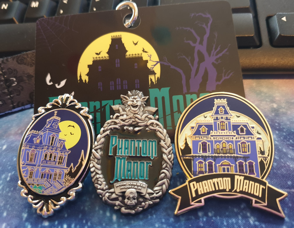 Three Phantom Manor badges and a lanyard